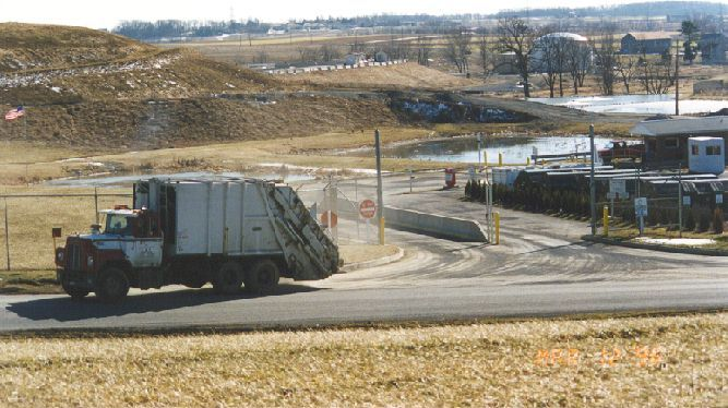 A dump truck leaving a facility